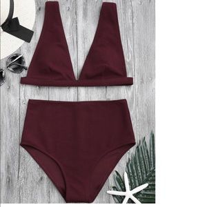 Maroon bathing suit.
